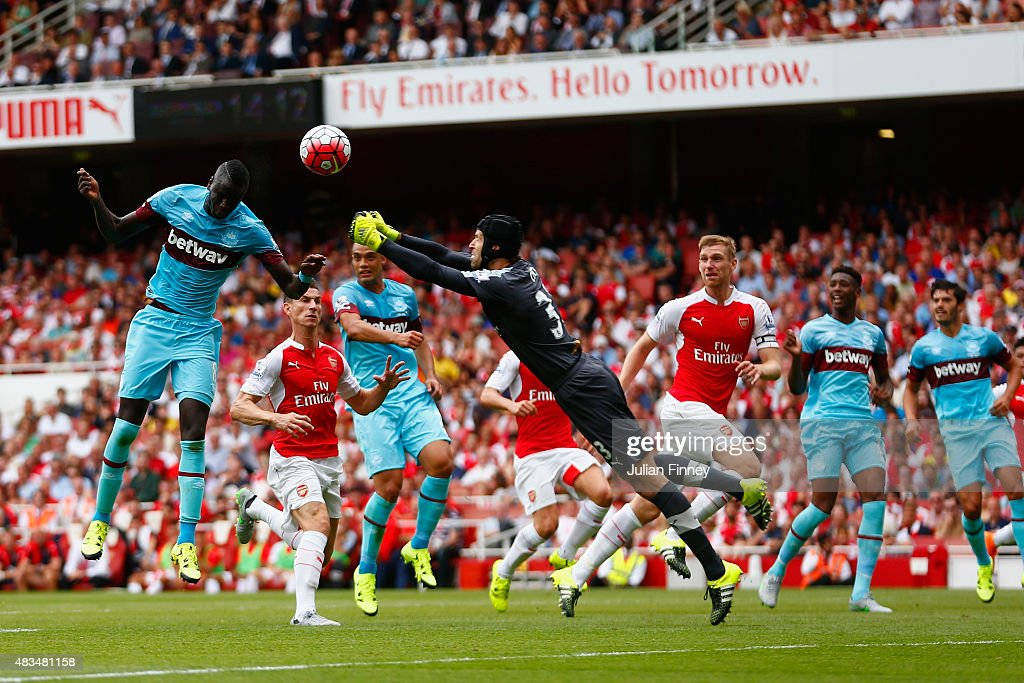 <a gi-track='captionPersonalityLinkClicked' href=/galleries/search?phrase=Petr+Cech&family=editorial&specificpeople=212890 ng-click='$event.stopPropagation()'>Petr Cech</a> of Arsenal fails to punch clear the ball as Cheikhou Kouyate of West Ham United heads in the opening goal during the Barclays Premier League match between Arsenal and West Ham United at the Emirates Stadium on August 9, 2015 in London, England.