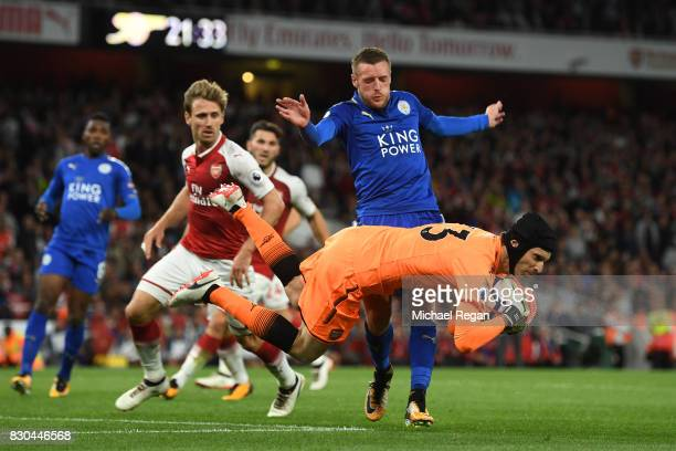 Petr Cech of Arsenal falls on the ball as Jamie Vardy of Leicester City closes in during the Premier League match between Arsenal and Leicester City...