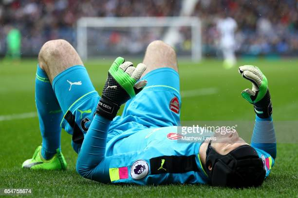 Petr Cech of Arsenal goes down injured during the Premier League match between West Bromwich Albion and Arsenal at The Hawthorns on March 18 2017 in...