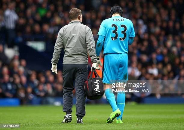 Petr Cech of Arsenal is helped off during the Premier League match between West Bromwich Albion and Arsenal at The Hawthorns on March 18 2017 in West...