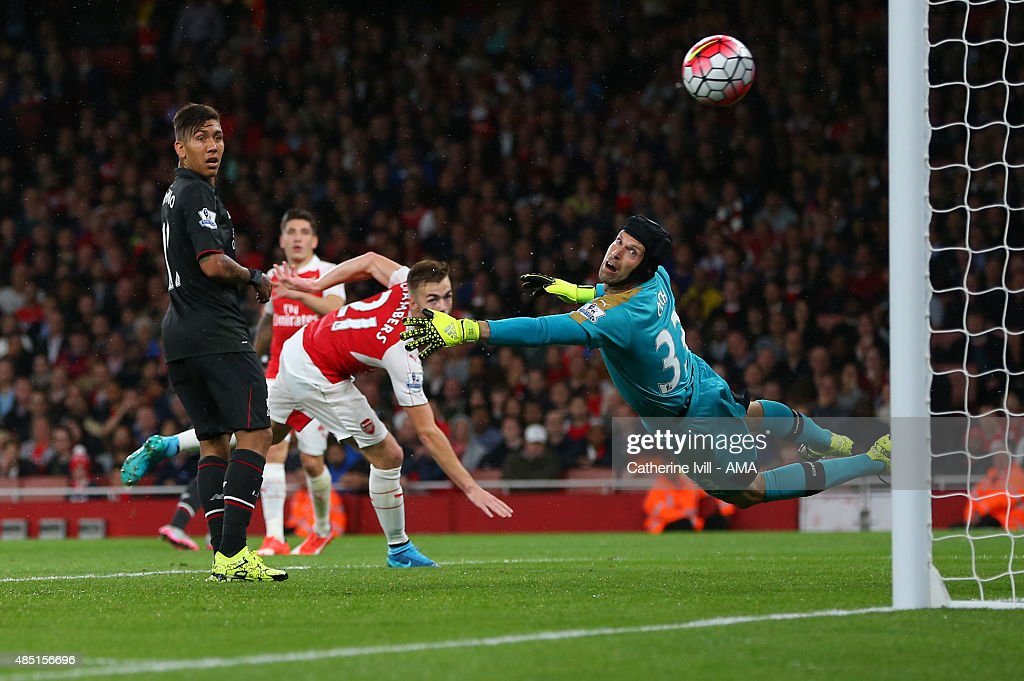 Petr Cech of Arsenal looks back after he saves from Philippe Coutinho of Liverpool during the Barclays Premier League match between Arsenal and Liverpool at the Emirates Stadium on August 24, 2015 in London, United Kingdom.