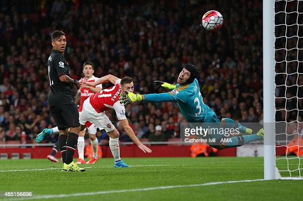 Petr Cech of Arsenal looks back after he saves from Philippe Coutinho of Liverpool during the Barclays Premier League match between Arsenal and...
