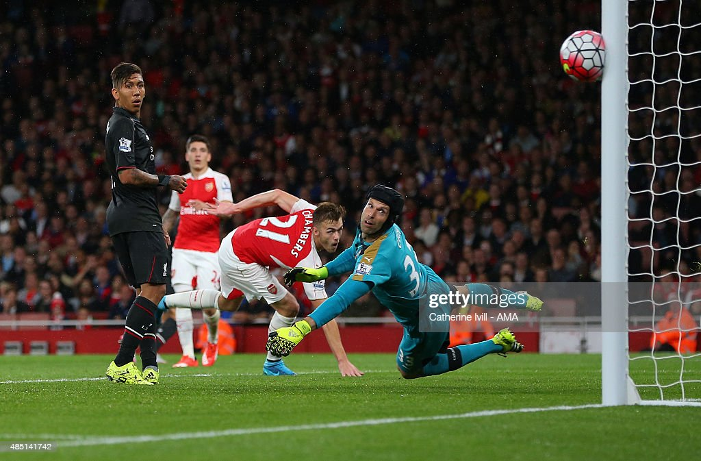 Petr Cech of Arsenal looks back as a shot from Philippe Coutinho of Liverpool hits the post during the Barclays Premier League match between Arsenal and Liverpool at the Emirates Stadium on August 24, 2015 in London, United Kingdom.