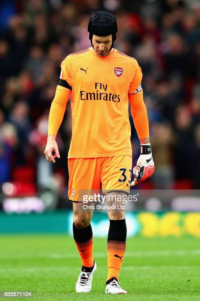Petr Cech of Arsenal looks dejected following the Premier League match between Stoke City and Arsenal at Bet365 Stadium on August 19 2017 in Stoke on...