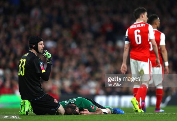 Petr Cech of Arsenal looks over an injured Matt Rhead of Lincoln City during The Emirates FA Cup QuarterFinal match between Arsenal and Lincoln City...