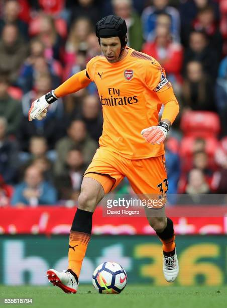 Petr Cech of Arsenal passes the ball during the Premier League match between Stoke City and Arsenal at Bet365 Stadium on August 19 2017 in Stoke on...