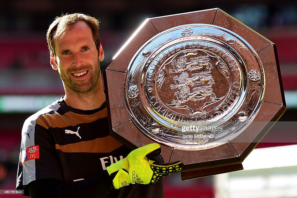 Petr Cech of Arsenal poses for photographs with the trophy after his team's 1-0 win in the FA Community Shield match between Chelsea and Arsenal at Wembley Stadium on August 2, 2015 in London, England.