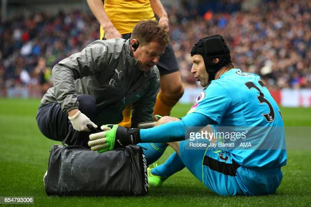 Petr Cech of Arsenal reacts to an injury during the Premier League match between West Bromwich Albion and Arsenal at The Hawthorns on March 18 2017...