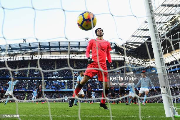 Petr Cech of Arsenal reacts to conceding a penalty from Sergio Aguero of Manchester City during the Premier League match between Manchester City and...