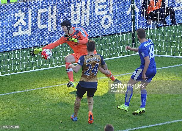 Petr Cech of Arsenal saves from Andrej Kramaric of Leicester during the Barclays Premier League match between Leicester City and Arsenal on September...