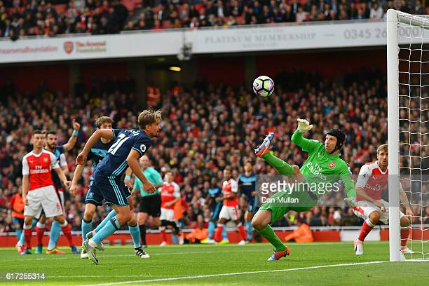 Petr Cech of Arsenal saves Gaston Ramirez of Middlesbrough header during the Premier League match between Arsenal and Middlesbrough at Emirates...