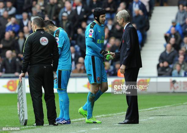 Petr Cech of Arsenal shakes hands with Arsene Wenger the Arsenal Manager as he comes off during the Premier League match between West Bromwich Albion...