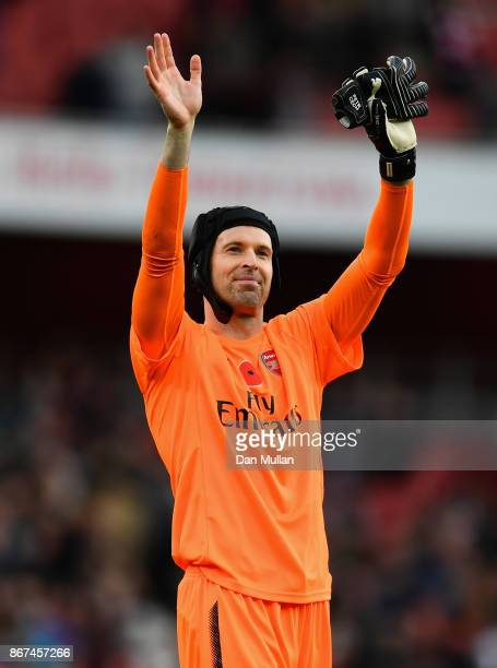 Petr Cech of Arsenal shows appreciation to the fans after the Premier League match between Arsenal and Swansea City at Emirates Stadium on October 28...