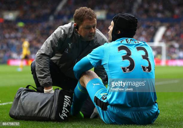 Petr Cech of Arsenal speaks to a memeber of the Arsenal medical team during the Premier League match between West Bromwich Albion and Arsenal at The...