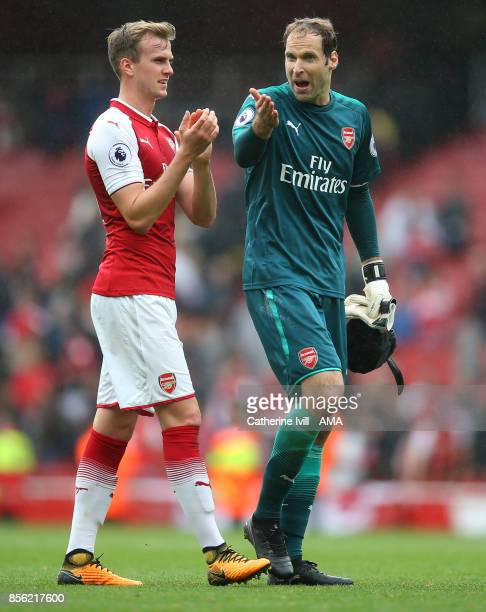 Petr Cech of Arsenal talks to Rob Holding of Arsenal after the Premier League match between Arsenal and Brighton and Hove Albion at Emirates Stadium...