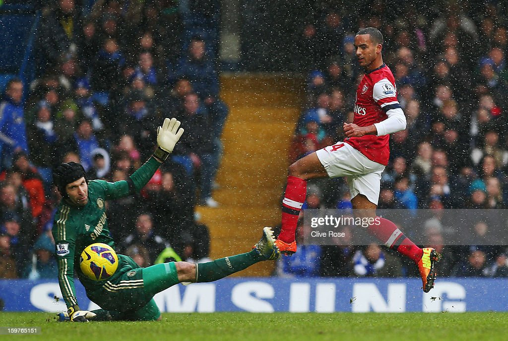 Petr Cech of Chelsea attempts to stop Theo Walcott of Arsenal during the Barclays Premier League match between Chelsea and Arsenal at Stamford Bridge on January 20, 2013 in London, England.