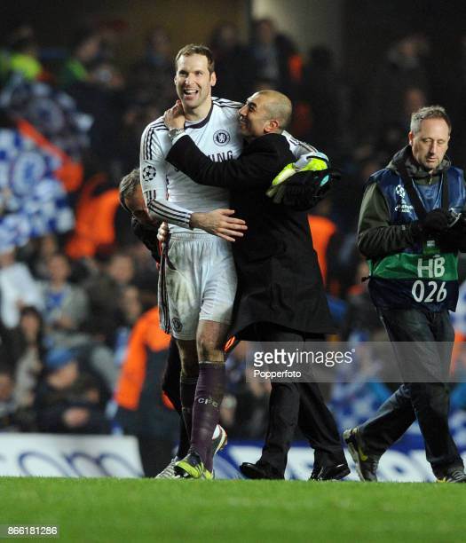 Petr Cech of Chelsea celebrates with manager Roberto Di Matteo after the UEFA Champions League match between Chelsea and Napoli at Stamford Bridge on...