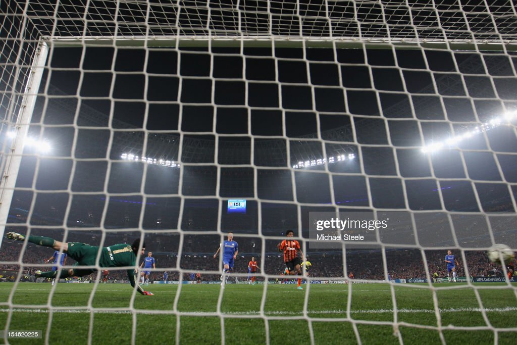 Petr Cech (L) of Chelsea dives in vain as Fernandinho (OUT OF FRAME) scores the second goal for Shakhtar Donetsk during the UEFA Champions League Group E match between Shakhtar Donetsk and Chelsea at the Donbass Arena on October 23, 2012 in Donetsk, Ukraine.