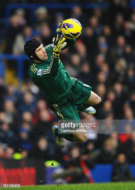 Petr Cech of Chelsea dives to make a save during the Barclays Premier League match between Chelsea and Wigan Athletic at Stamford Bridge on February...