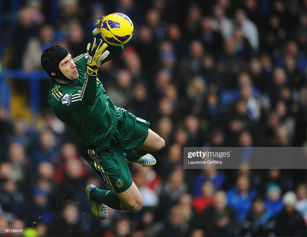 <a gi-track='captionPersonalityLinkClicked' href=/galleries/search?phrase=Petr+Cech&family=editorial&specificpeople=212890 ng-click='$event.stopPropagation()'>Petr Cech</a> of Chelsea dives to make a save during the Barclays Premier League match between Chelsea and Wigan Athletic at Stamford Bridge on February 9, 2013 in London, England.