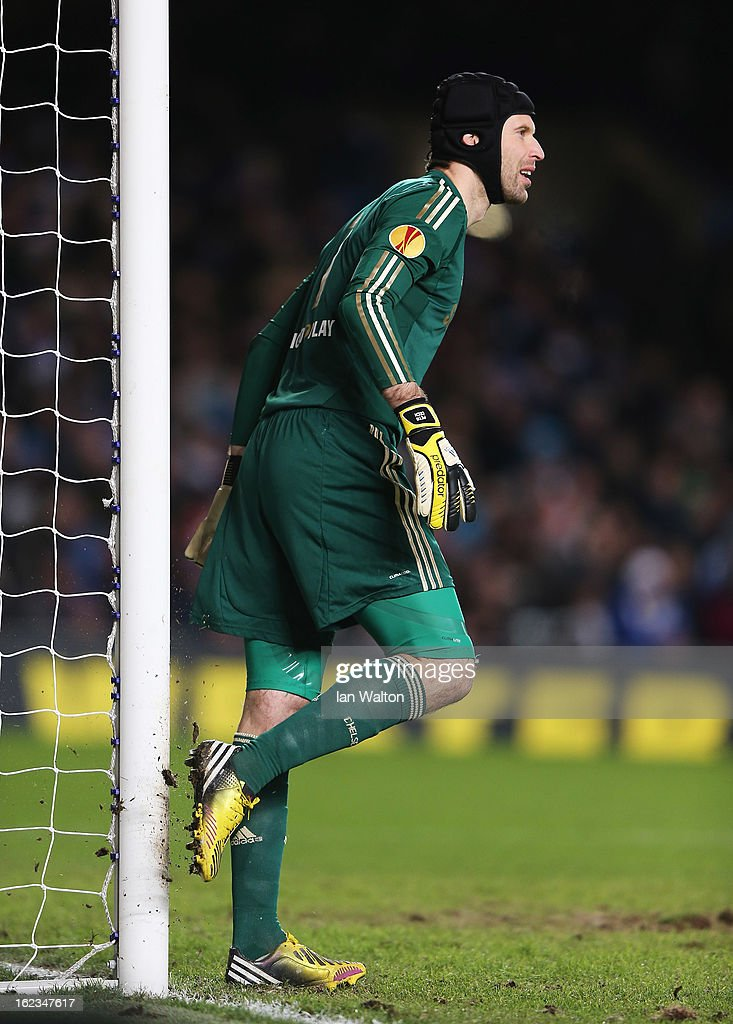 Petr Cech of Chelsea kicks mud off his boots during the UEFA Europa League Round of 32 second leg match between Chelsea and Sparta Praha at Stamford Bridge on February 21, 2013 in London, England.