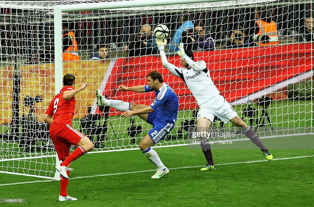 <a gi-track='captionPersonalityLinkClicked' href=/galleries/search?phrase=Petr+Cech&family=editorial&specificpeople=212890 ng-click='$event.stopPropagation()'>Petr Cech</a> of Chelsea saves a header from <a gi-track='captionPersonalityLinkClicked' href=/galleries/search?phrase=Andy+Carroll+-+Soccer+Player&family=editorial&specificpeople=1449090 ng-click='$event.stopPropagation()'>Andy Carroll</a> of Liverpool during the FA Cup Final with Budweiser between Liverpool and Chelsea at Wembley Stadium on May 5, 2012 in London, England.