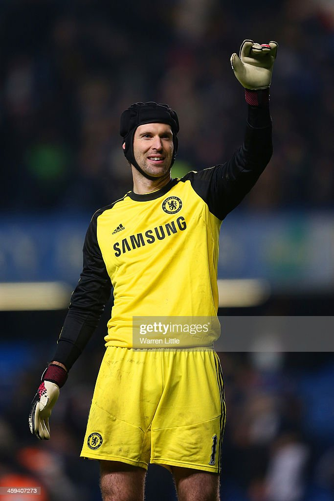 <a gi-track='captionPersonalityLinkClicked' href=/galleries/search?phrase=Petr+Cech&family=editorial&specificpeople=212890 ng-click='$event.stopPropagation()'>Petr Cech</a> of Chelsea waves to the fans after the game during the Barclays Premier League match between Chelsea and Swansea City at Stamford Bridge on December 26, 2013 in London, England.