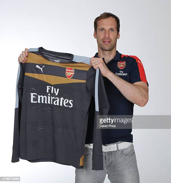 Petr Cech signs for Arsenal Football Club at the Arsenal Training Ground at London Colney on June 26 2015 in St Albans England