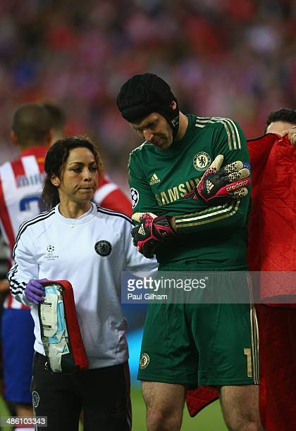 Petr Cech walks off the pitch after being injured during the UEFA Champions League Semi Final first leg match between Club Atletico de Madrid and...