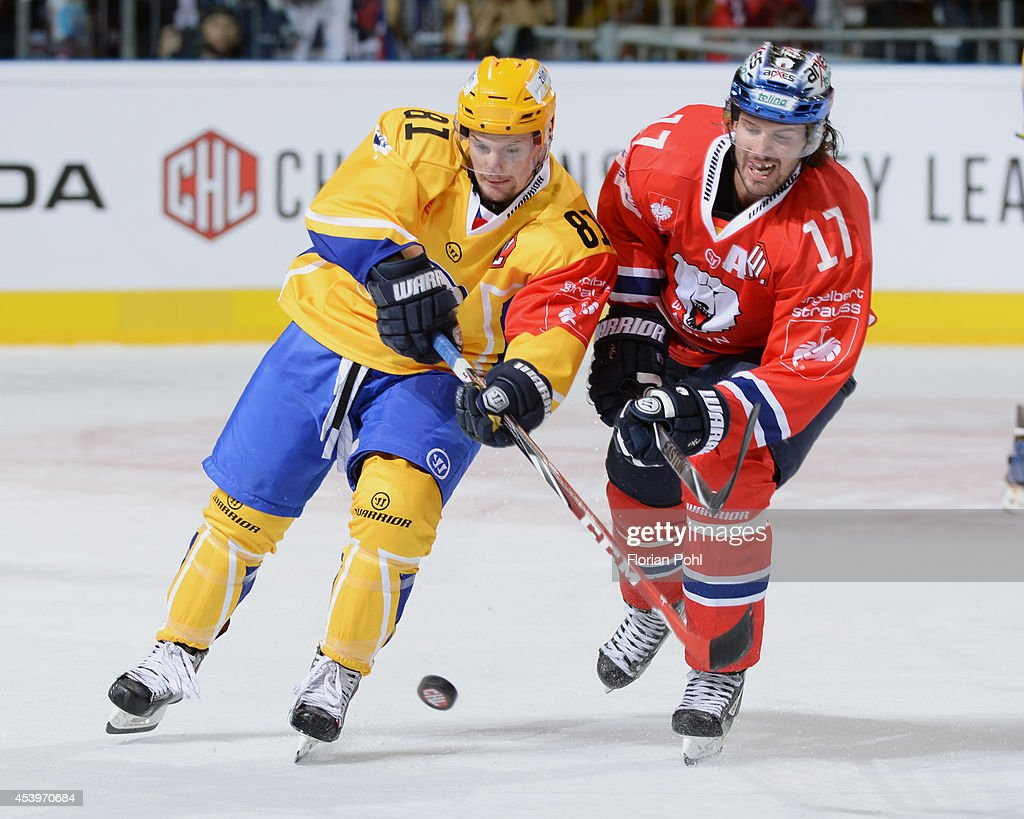 Petr Holik #81 of PSG Zlin struggles for the puck with Mark Bell #17 of Eisbären Berlin during the Champions Hockey League group stage game between Eisbaeren Berlin and HC Zlin on August 22, 2014 in Berlin, Germany.