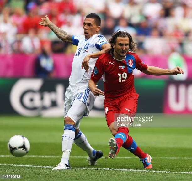 Petr Jiracek of Czech Republic scores the opening goal during the UEFA EURO 2012 group A match between Greece and Czech Republic at The Municipal...