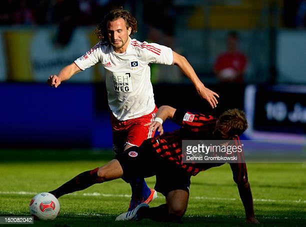 Petr Jiracek of Hamburg and Stefan Aigner of Frankfurt battle for the ball during the Bundesliga match between Eintracht Frankfurt and Hamburger SV...