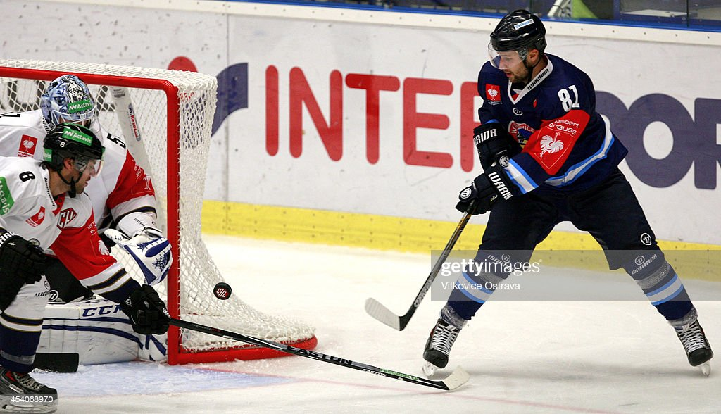 Petr Kolouch of Vitkovice Ostrava attempts a shot during the Champions Hockey League group stage game between Vitkovice Ostrave and EV Zug on August 23, 2014 in Ostrava, Czech Republic.