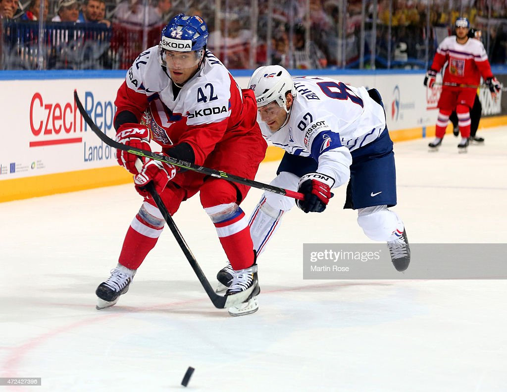 Petr Koukal (L) of Czech Republic and Charles Bertrand (R) of France battle for the puck during the IIHF World Championship group A match between Czech Republic and France at o2 Arena on May 7, 2015 in Prague, Czech Republic.