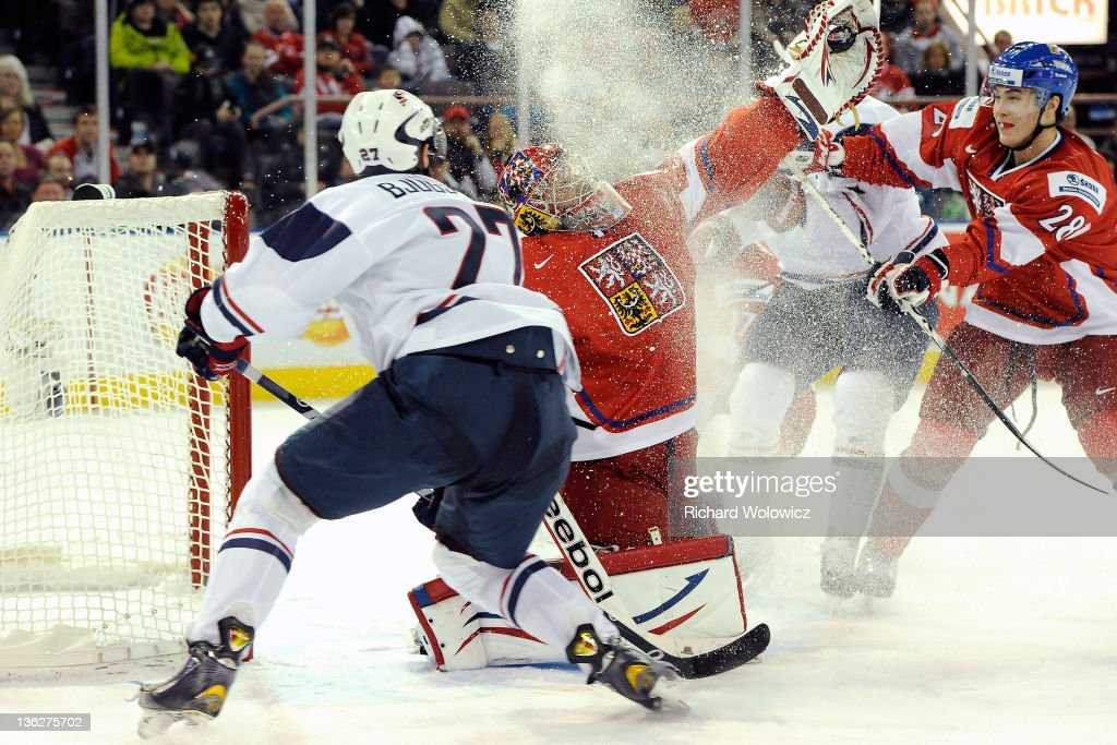 Petr Mrazek of Team Czech Republic makes a glove save on the puck in front of Nick Bjugstad of Team USA during the 2012 World Junior Hockey...