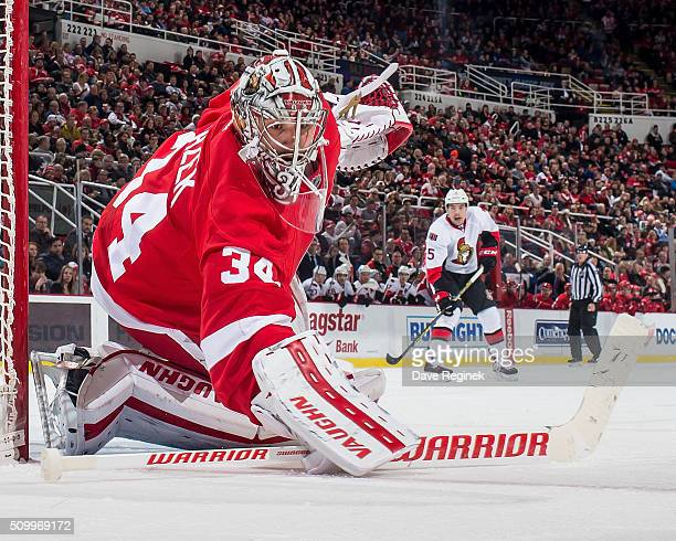 Petr Mrazek of the Detroit Red Wings follows the play during an NHL game against the Ottawa Senators at Joe Louis Arena on February 10 2016 in...