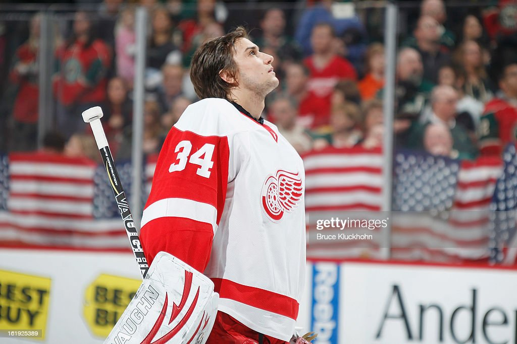 Petr Mrazek #34 of the Detroit Red Wings looks at the American flag during the National Anthem prior to the game against the Minnesota Wild on February 17, 2013 at the Xcel Energy Center in Saint Paul, Minnesota.