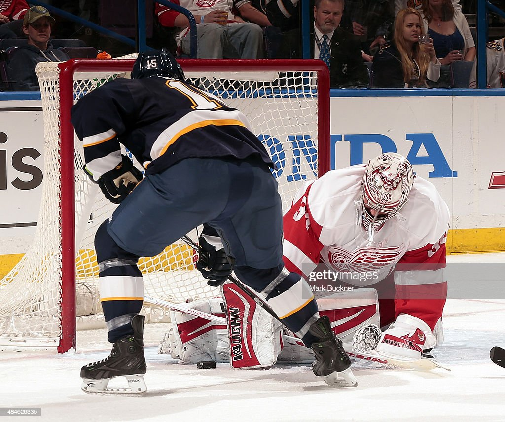 Petr Mrazek of the Detroit Red Wings makes a pad save against Keith Aucoin of the St Louis Blues during an NHL game on April 13 2014 at Scottrade...