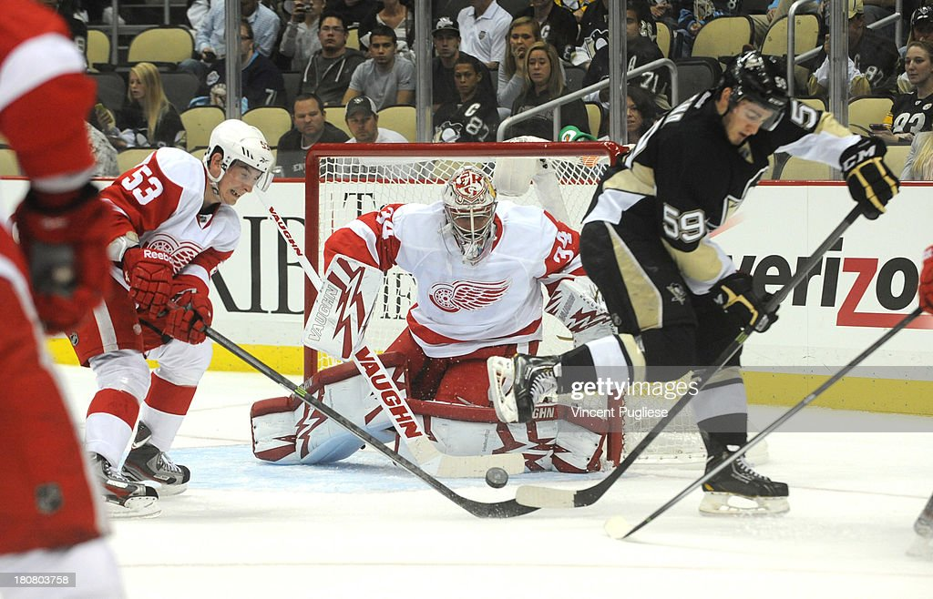 <a gi-track='captionPersonalityLinkClicked' href=/galleries/search?phrase=Petr+Mrazek&family=editorial&specificpeople=6514148 ng-click='$event.stopPropagation()'>Petr Mrazek</a> #34 of the Detroit Red Wings makes a save off of a deflection by Jayson Megna # 59 of the Pittsburgh Penguins during the third period of a preseason game on September 16, 2013 at the CONSOL Energy Center in Pittsburgh, Pennsylvania.