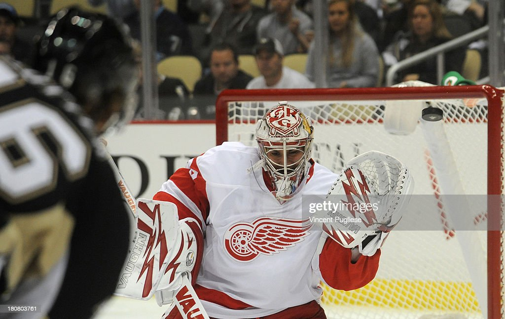 <a gi-track='captionPersonalityLinkClicked' href=/galleries/search?phrase=Petr+Mrazek&family=editorial&specificpeople=6514148 ng-click='$event.stopPropagation()'>Petr Mrazek</a> #34 of the Detroit Red Wings makes a save off of a shot by Brandon Sutter #16 of the Pittsburgh Penguins during the third period on September 16, 2013 at the CONSOL Energy Center in Pittsburgh, Pennsylvania.