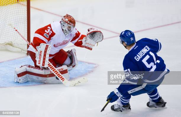 Petr Mrazek of the Detroit Red Wings makes a save on Jake Gardiner of the Toronto Maple Leafs during the third period at the Air Canada Centre on...