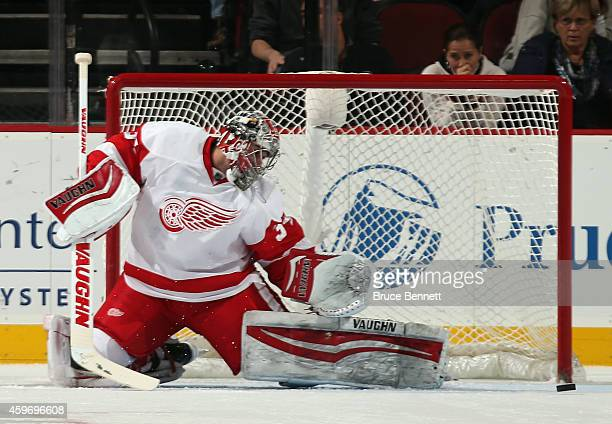Petr Mrazek of the Detroit Red Wings makes the first period save against the New Jersey Devils at the Prudential Center on November 28 2014 in Newark...