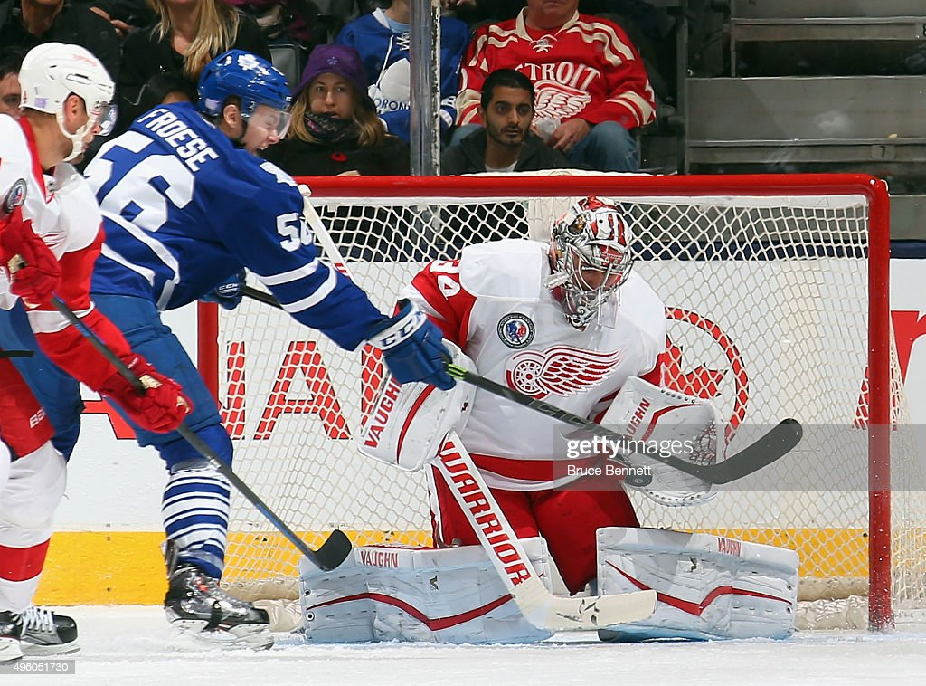<a gi-track='captionPersonalityLinkClicked' href=/galleries/search?phrase=Petr+Mrazek&family=editorial&specificpeople=6514148 ng-click='$event.stopPropagation()'>Petr Mrazek</a> #34 of the Detroit Red Wings makes the second period save on Byron Froese #56 of the Toronto Maple Leafs at the Air Canada Centre on November 6, 2015 in Toronto, Ontario, Canada.