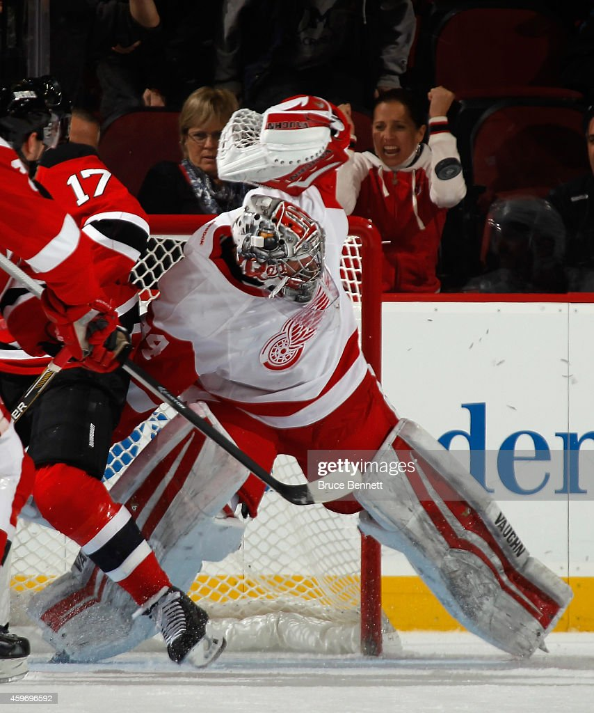 Petr Mrazek #34 of the Detroit Red Wings makes the third period save against the New Jersey Devils at the Prudential Center on November 28, 2014 in Newark, New Jersey. The Red Wings defeated the Devils 5-4 in the shootout. With the win, the Red Wings recorded their 1000th NHL victory which is the league's all-time high.