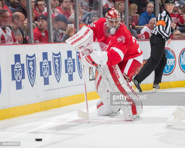 Petr Mrazek of the Detroit Red Wings passes the puck against the New York Islanders during an NHL game at Joe Louis Arena on February 21 2017 in...