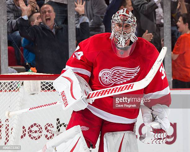 Petr Mrazek of the Detroit Red Wings pumps his arm after making the final save in a shootout to win the game against the Buffalo Sabres at Joe Louis...