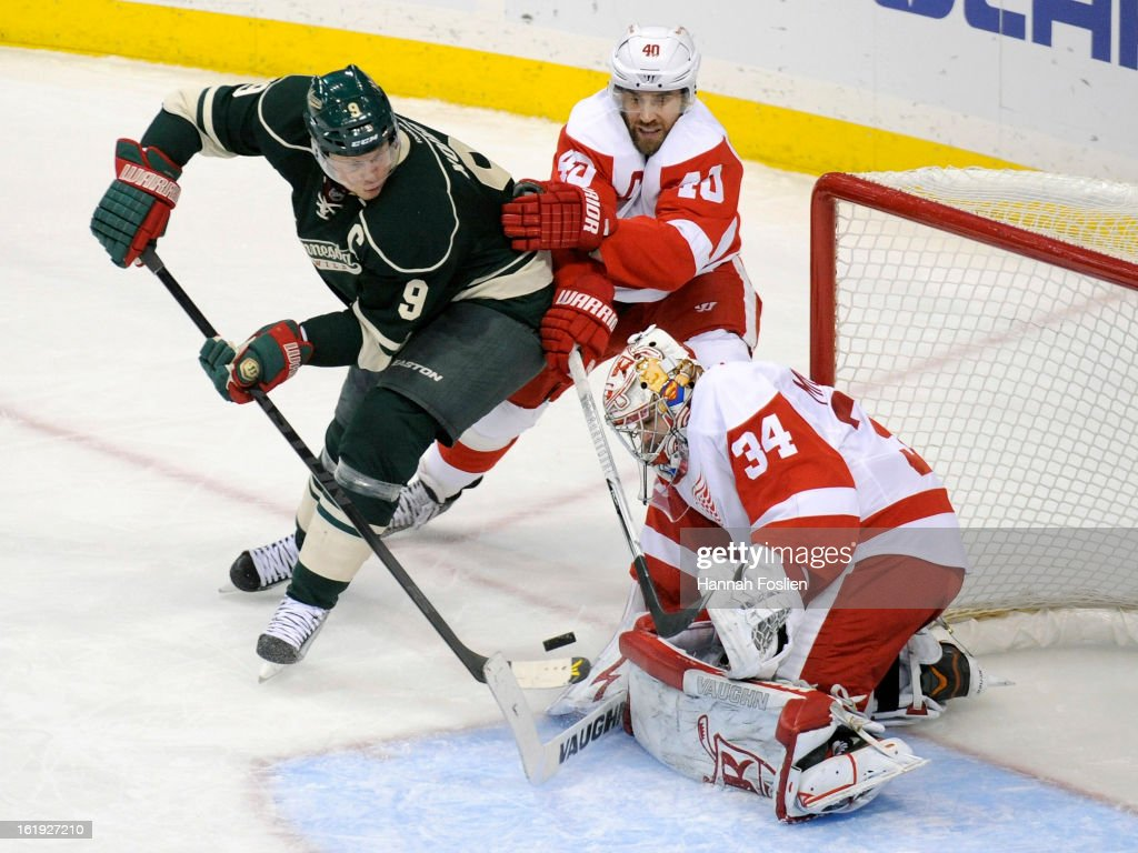 Petr Mrazek #34 of the Detroit Red Wings stops a shot by Mikko Koivu #9 of the Minnesota Wild with help from Henrik Zetterberg #40 of the Detroit Red Wings during the second period of the game on February 17, 2013 at Xcel Energy Center in St Paul, Minnesota.