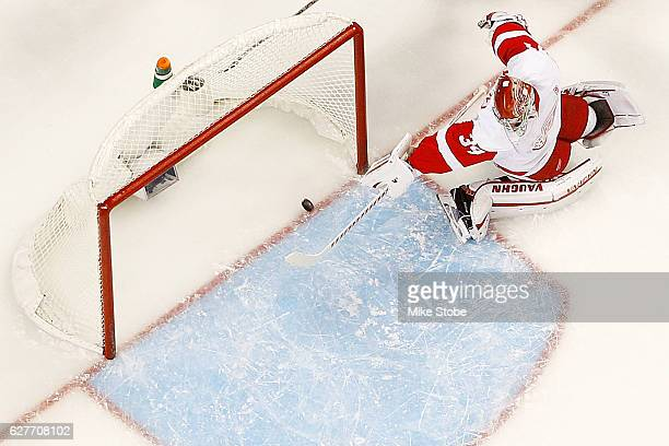 Petr Mrazek of the Detroit Red Wings watches Anders Lee of the New York Islanders first period goal into the net at the Barclays Center on December 4...