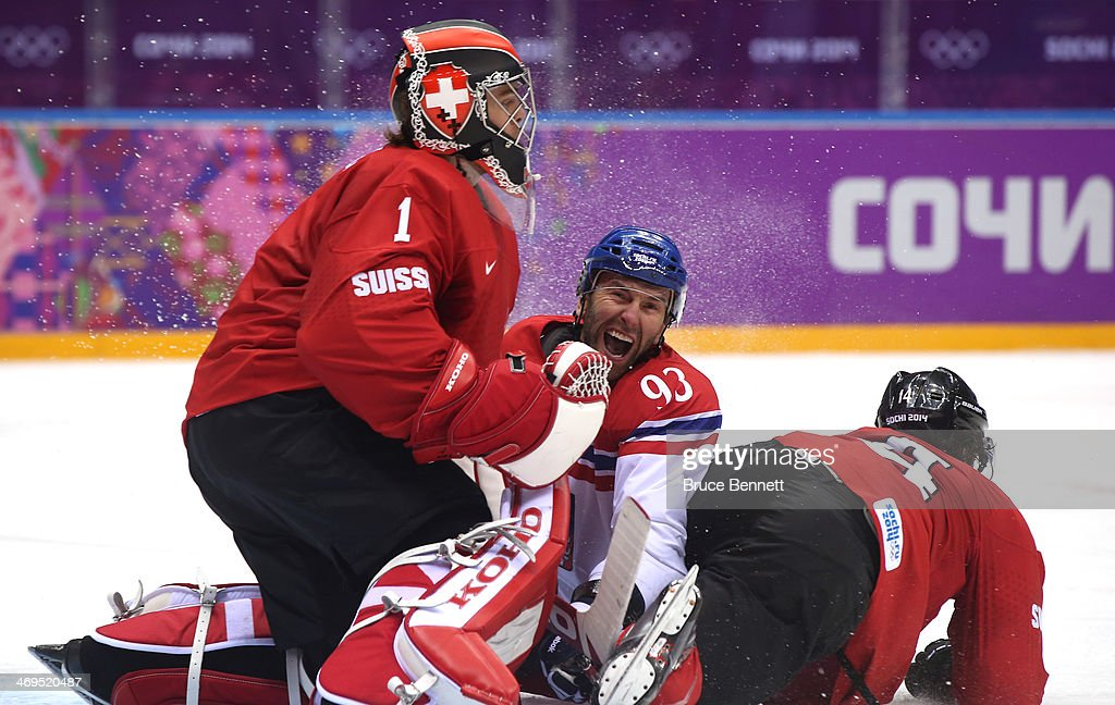 Petr Nedved #93 of the Czech Republic and Roman Wick #14 of Switzerland come crashing into Jonas Hiller #1 after a play at the net during the Men's Ice Hockey Preliminary Round Group C game on day eight of the Sochi 2014 Winter Olympics at Bolshoy Ice Dome on February 15, 2014 in Sochi, Russia.
