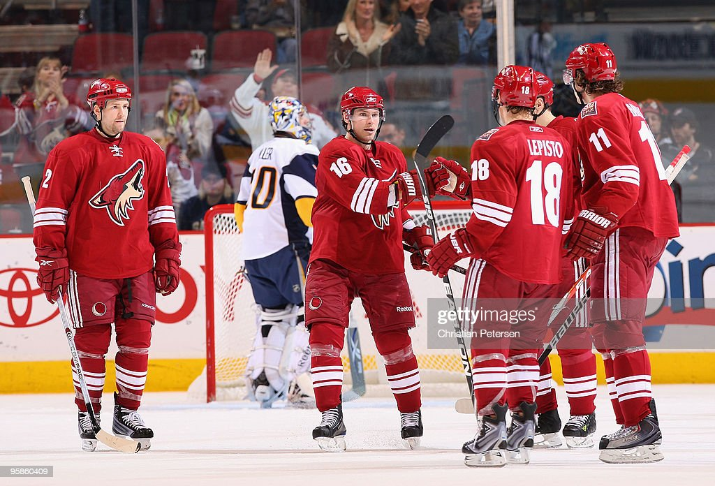 <a gi-track='captionPersonalityLinkClicked' href=/galleries/search?phrase=Petr+Prucha&family=editorial&specificpeople=570763 ng-click='$event.stopPropagation()'>Petr Prucha</a> #16 of the Phoenix Coyotes celebrates with teammates after assisting on a third period goal scored by Radim Vrbata during the NHL game against the Buffalo Sabres at Jobing.com Arena on January 18, 2010 in Glendale, Arizona. The Sabres defeated the Coyotes 7-2.